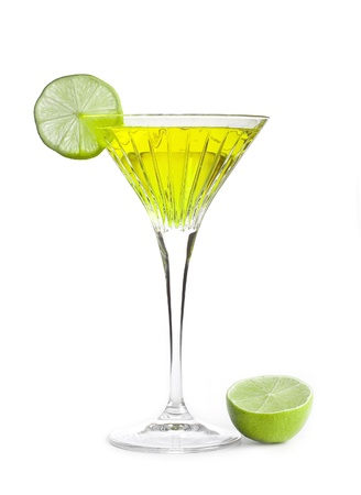 yellow alcoholic cocktail with a slice of lime photo