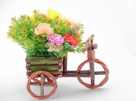 petunias: colorfule flower on basker bicycle Stock Photo