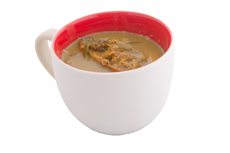 curry in white cup on white background photo