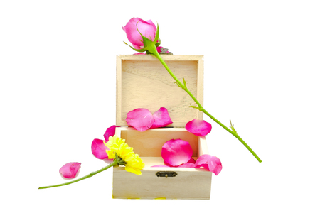 brown box: pink rose on little wooden brown box Stock Photo