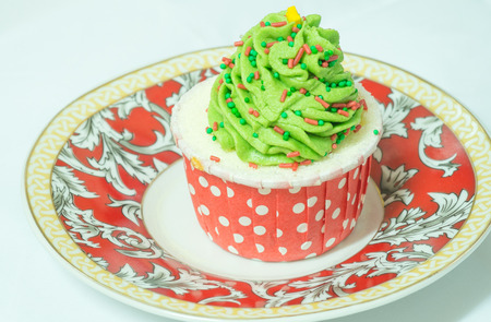 butter icing: cupcake with butter cream icing on circle dish Stock Photo