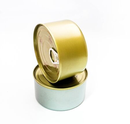 tinned: closed tin can with open key on white background