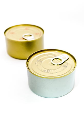 tinned: closed tin can with open key on white background , selective focus