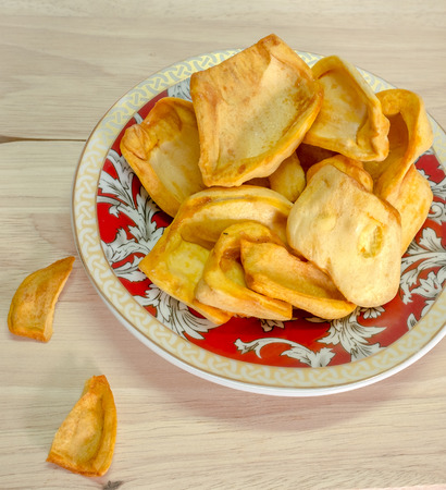 small plate: dried jackfruit chips in small plate on background. Stock Photo