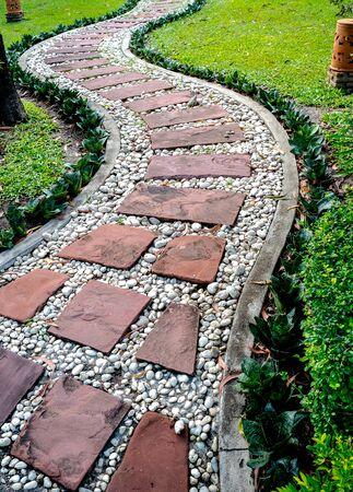 garden green: brick sidewalk in garden, green park Stock Photo