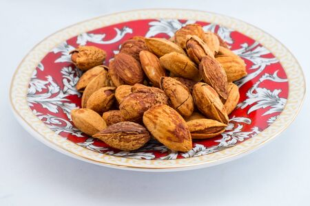 buttered: buttered roast almond with hard shell on plate