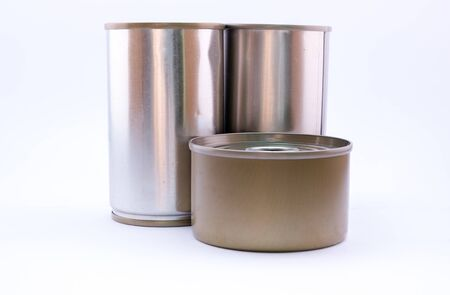 tinned: closed tin and long can with open key on white background Stock Photo