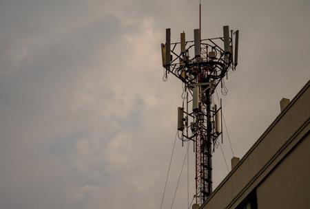 mobile communication: silhouette mobile antenna tower, or silhouette telephone communication tower Stock Photo
