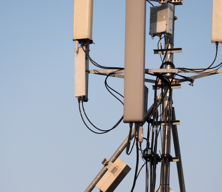 communication tower: silhouette mobile antenna tower, or silhouette telephone communication tower Stock Photo