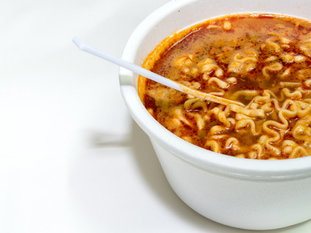 scald: Instant noodle food with hot water in white plastic foam cup