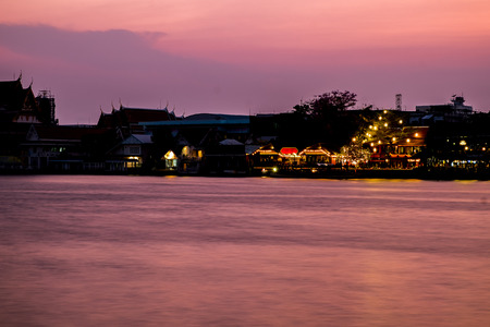 river banks: House and restaurant on the bank river in evening, Chao Playa Thailand