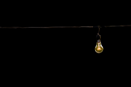 light bulb on black isolated background, concept of creativity. Stock Photo