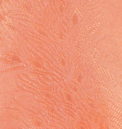 Orange clothes shiny velvet texture background. Banco de Imagens