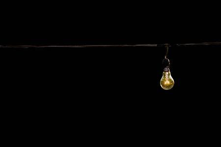 light bulb on black isolated background, concept of creativity. Banco de Imagens