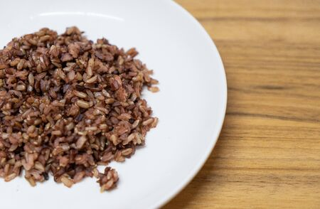 delicious brown cooked rice in white disk Banco de Imagens