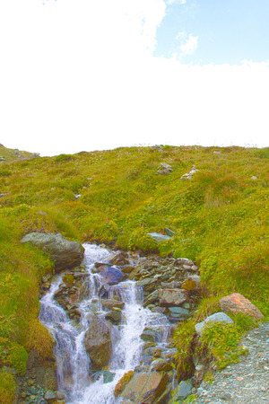 waterfall along a mountain path in Val D'Ayas Archivio Fotografico