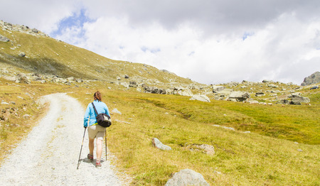 excursionist along a mountain path in Val D'Aosta in summer