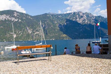 Bellagio, Italy - 13 August 2013: Lake port of Bellagio in summer time, Italy Редакционное