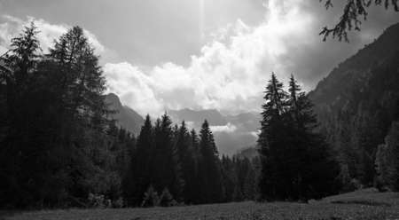 Alpine panorama in summer time, cloudy day on mountains