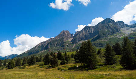 Alpine panorama in summer time, sunny day on a mountain trail