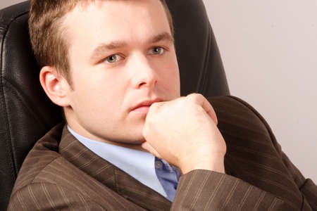 funy: thinking young business man - smart casual Stock Photo