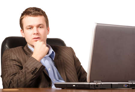 thinking business man with laptop - smart casual photo