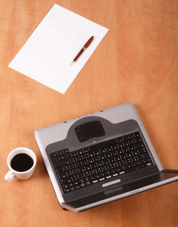 Blank paper,pen cup of coffee and laptop on the desk - office Stock Photo - 270533