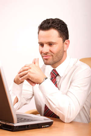 Busy thinking man with laptop having problem photo