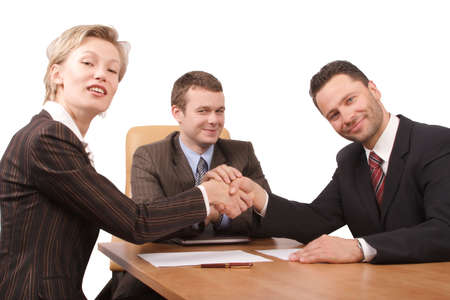 Three business people handhshake - deal - isolated. photo