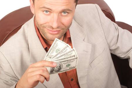 payola: Smiling man with few houndred dollars bills in the hand - close up Stock Photo