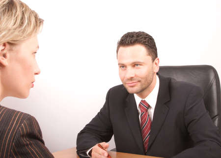 headhunting: White business man and woman talking - isolated Stock Photo