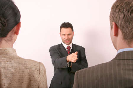 Handsome business man pointing at man - 1 Stock Photo - 433683