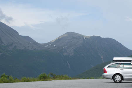 touring car: Silver car in the mountains