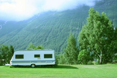 Modern caravan at the campsite in the mountains, general