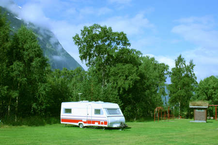 Modern caravan at the campsite in the mountains, general photo