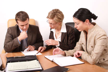 respectable: Group of business people working at the desk in the office