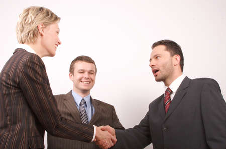 the etiquette: Group of  3 busisness people - man and woman hand shake