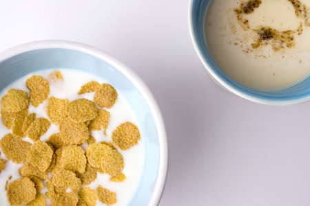 cup of cappuccino and bowl of cereal photo