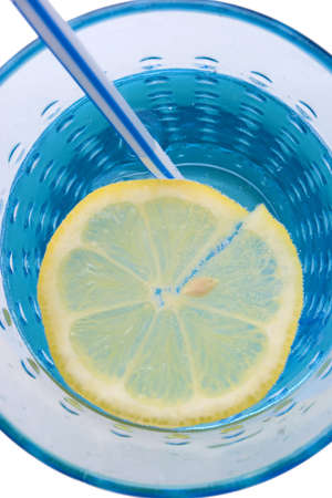 mineralized: glass of mineral water with lemon and straw on white background - close up