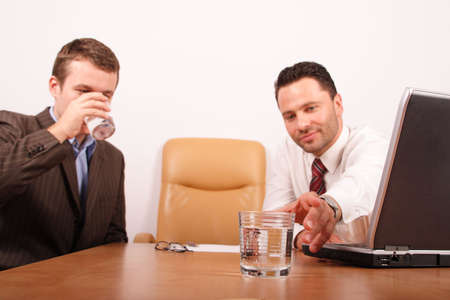 distilled water: two business men having brask for drinking water Stock Photo