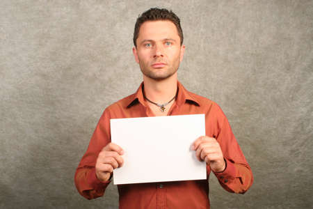 white man with card - space for copy, front photo