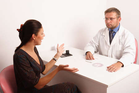 at the doctor's office - doctor is watching his  neurotic patient Stock Photo - 459377