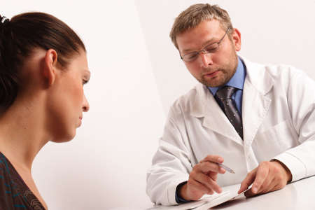 At the doctor's office - doctor explaining diagnosis to his female patient Stock Photo - 459364