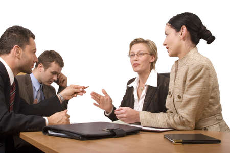 Group of business people,  two women two men negotiate at the desk