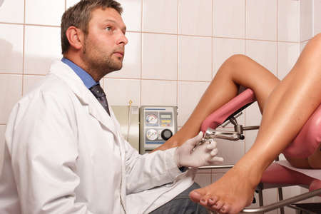 gynecologic: Gyneacologist performing patients examination Stock Photo