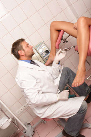 Gyneacologist performing patients examination Stock Photo