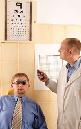 hyperopia: Eye doctor performing eye examination