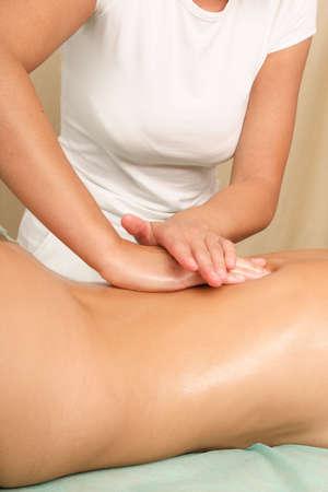suppression: A woman body getting a massage, close up