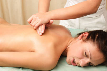 back rub: A woman getting a massage.