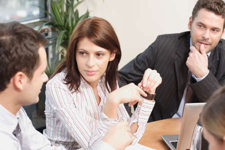 law report: Group of business people sitting at the table, working on project -2men and 1 woman  Stock Photo